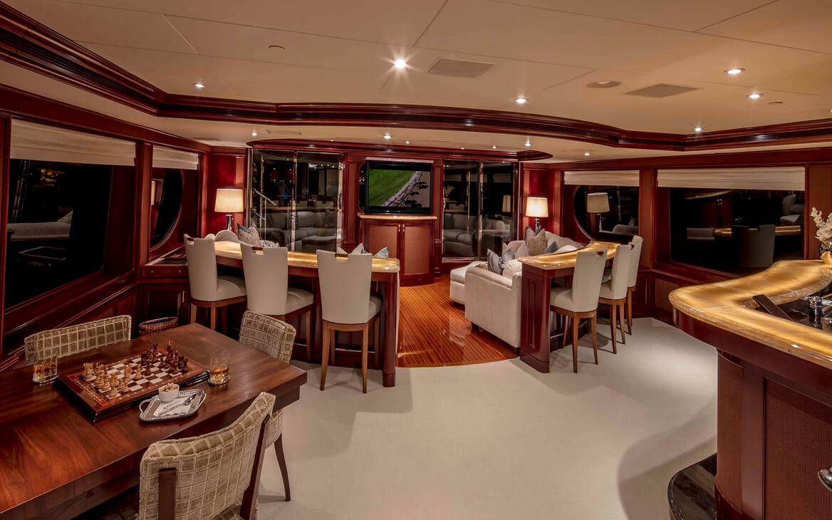 Motor yacht MILESTONE bar area with stool seating