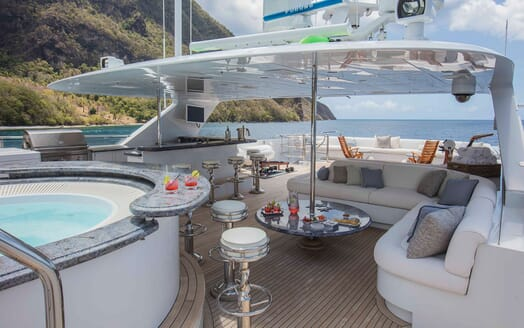Motor yacht MILESTONE deck shot with jacuzzi and seating