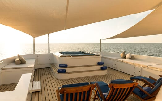 Motor yacht Northern Sun decking with blue sunloungers and jacuzzi