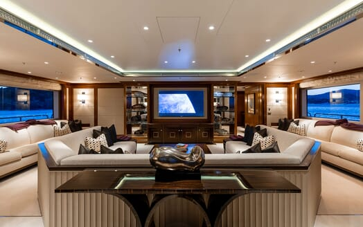 Motor Yacht SEANNA living room shot with large three piece cream sofa and large plasma TV