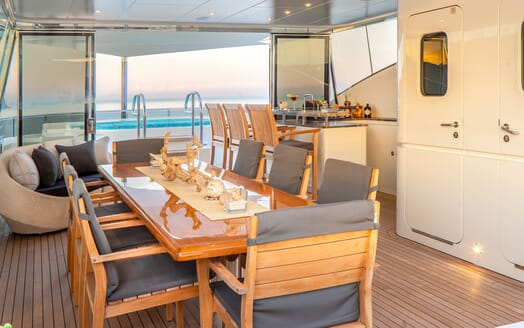Motor Yacht ODYSSEA Deck Dining Table, Bar and Jacuzzi
