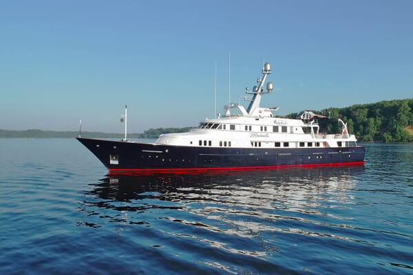 Motor Yacht Minderella hero shot with blue skies and water