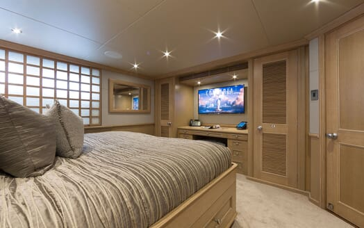 Motor yacht Minderella master suite with gold bed linen and plasma TV