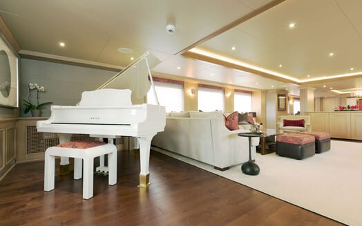 Motor yacht Minderella living room with white Yamaha piano