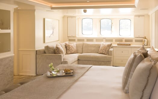 Motor yacht Minderella white stateroom with three windows