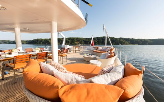 Motor Yacht Minderella decking with spacious seating area in orange and white