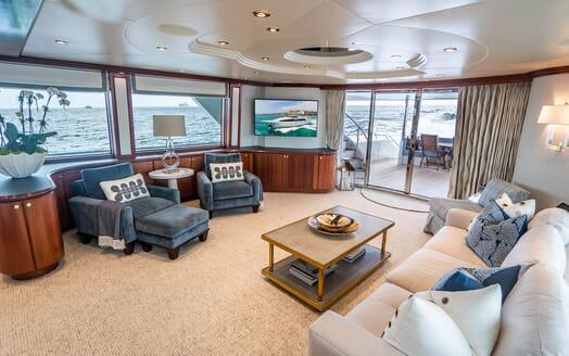 Motor Yacht RISK & REWARD Main Deck Salon with TV